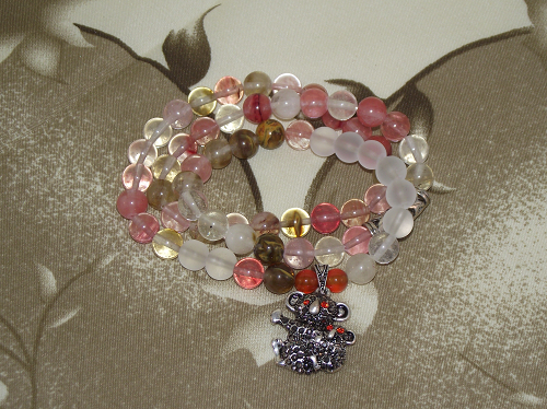 Crystal gemstone bracelets with a silver koala bear charm,