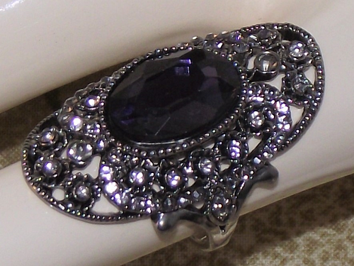 Celtic style dress ring with dark blue faux gemstones,