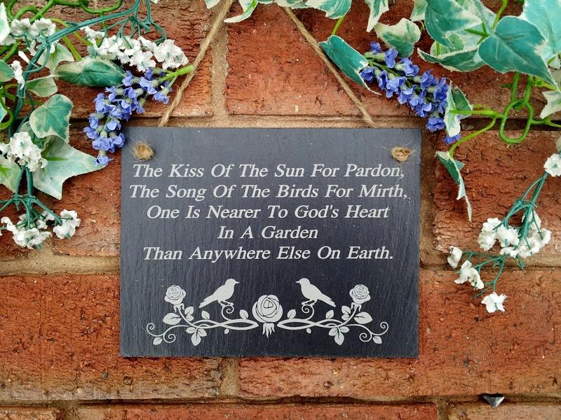the kiss of the sun for pardon garden slate plaque