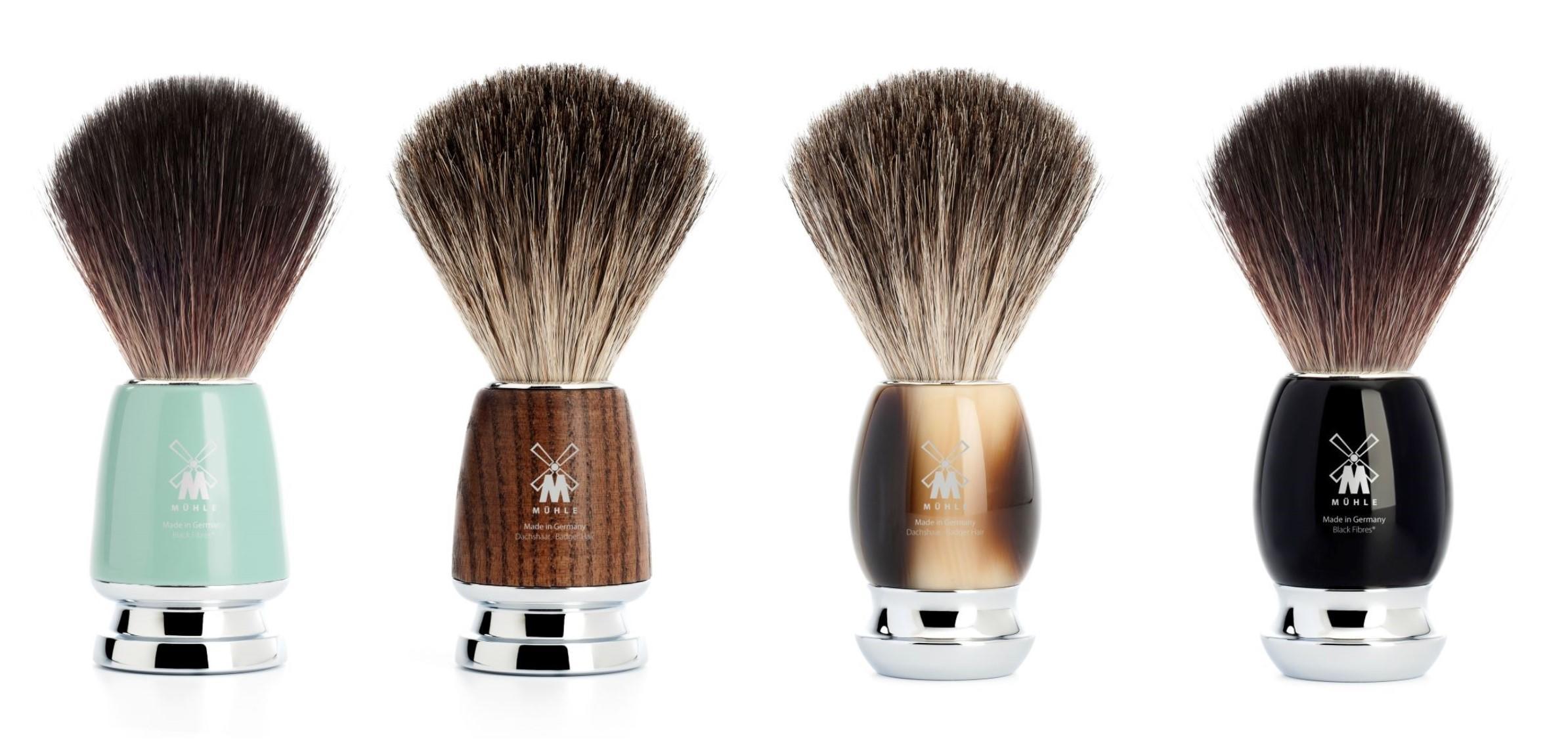 (from left to right): The Mint RYTMO Black Fibre Shaving Brush (21M224), The Steamed Ash RYTMO Pure Badger Shaving Brush (81H220), The Horn Resin VIVO Pure Badger Shaving Brush (81M332), The Black Resin VIVO Black Fibre Shaving Brush (21M336)