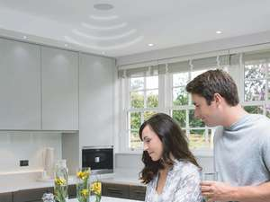grey kitchen with couple and systemline e50 in wall