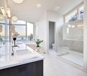 white bathroom with waterproof in ceiling speakers