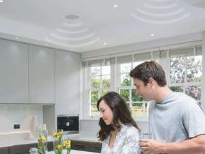 couple in kitchen with systemline e50 installed in wall