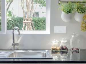 silver and white kitchen sink area with systemline e50 white