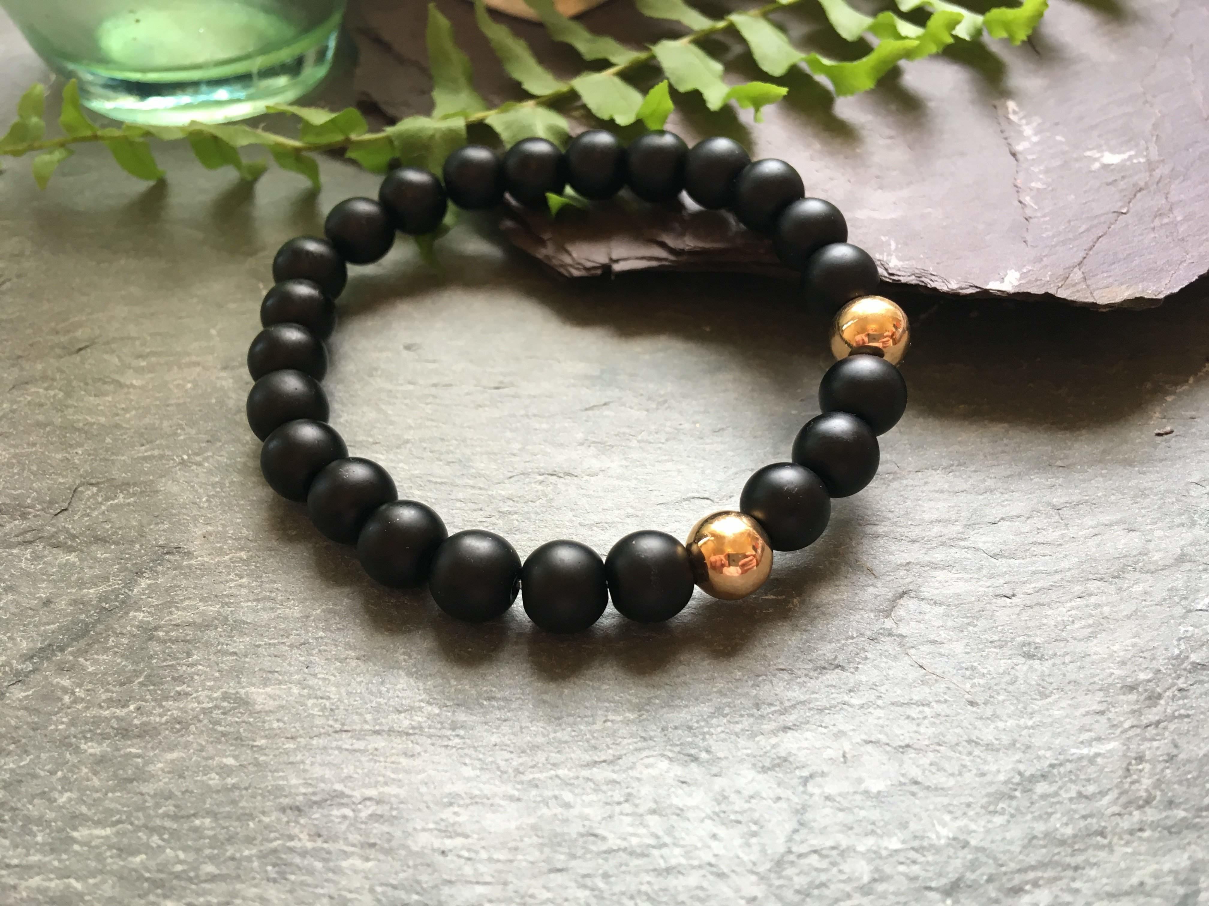 Black And Gold Stylish Bead Bracelet 2 Rose Coloured Metal Beads Liv