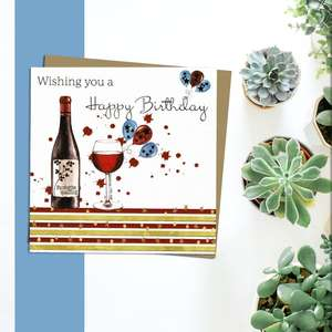 Red Wine And Balloons Birthday Card Alongside Its Silver Envelope