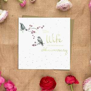 Wife Anniversary Greeting Card Alongside Its Kraft Envelope
