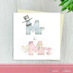 A Blue Mr With A Top Hat And Bow Tie and A Pink Mrs With A Veil And Bouquet Makes This Wedding Day Card So Pretty! With Gold And Silver Accents And Ivory Envelope