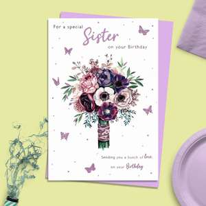Sister Floral Birthday Card Alongside Its Lilac Envelope