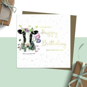 ' Wishing You A Happy Birthday Have A Fabulous Day' Design Featuring A Beautiful Friesian Cow Decorated With Flowers, Balloons, Butterflies and Bees. With Added Sparkle And jewel embellishment. Blank Inside for Own Message. Complete With Brown Kraft Envelope