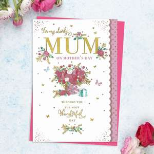 ' For My Lovely Mum On Mother's Day' Featuring A Tied Bouquet With Butterflies, Gift And Gold Foil Detail. With Sparkle Scalloped Edge Effect And bright Pink Envelope