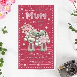' For A Very Lovely Mum From Both Of Us' Mother's Day Card. Featuring Hun Bun With Flowers! Complete With Silver foil Detail and White Envelope With Pink Hearts