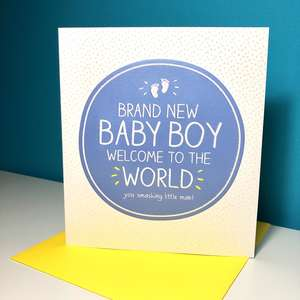 Baby Boy Congrats Card Alongside Its Yellow Envelope