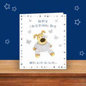 Boofle Christening Card Sitting On A Wooden Shelf