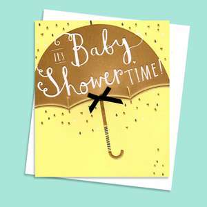 Baby Shower Umbrella Yellow Congrats Card Alongside Its White Envelope