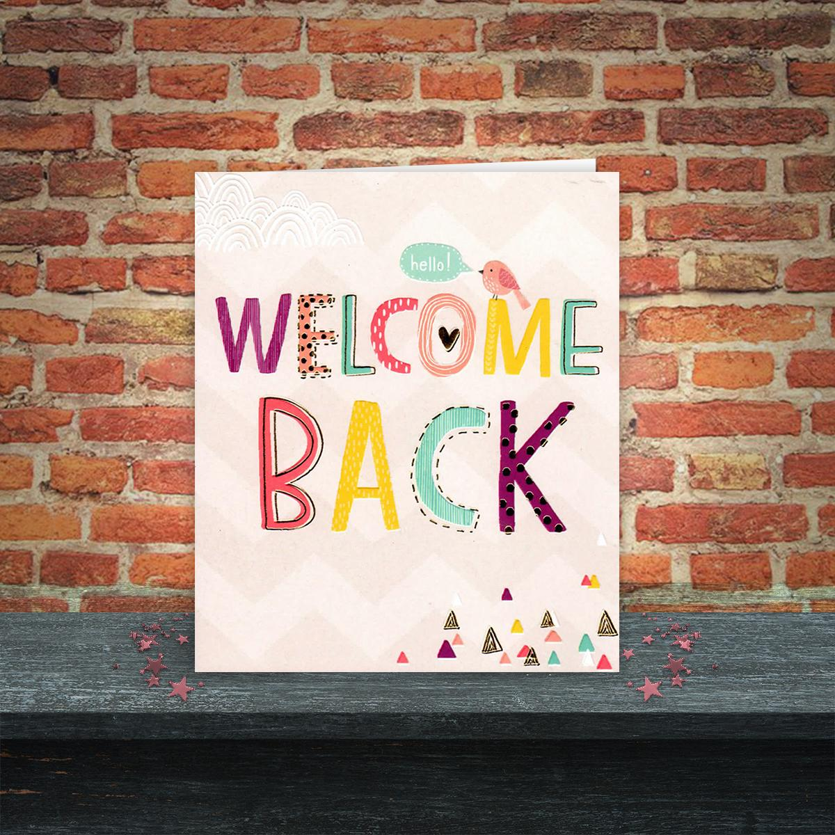 Welcome Back Greeting Card Sitting On A Display Shelf