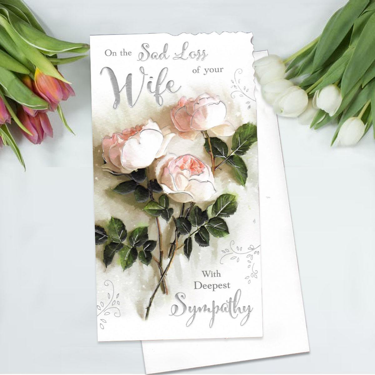 Floral Loss Of Wife Sympathy Card Alongside Its White Envelope