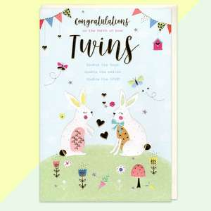 Birth Of Twins Baby Card Displayed Alongside Its Envelope