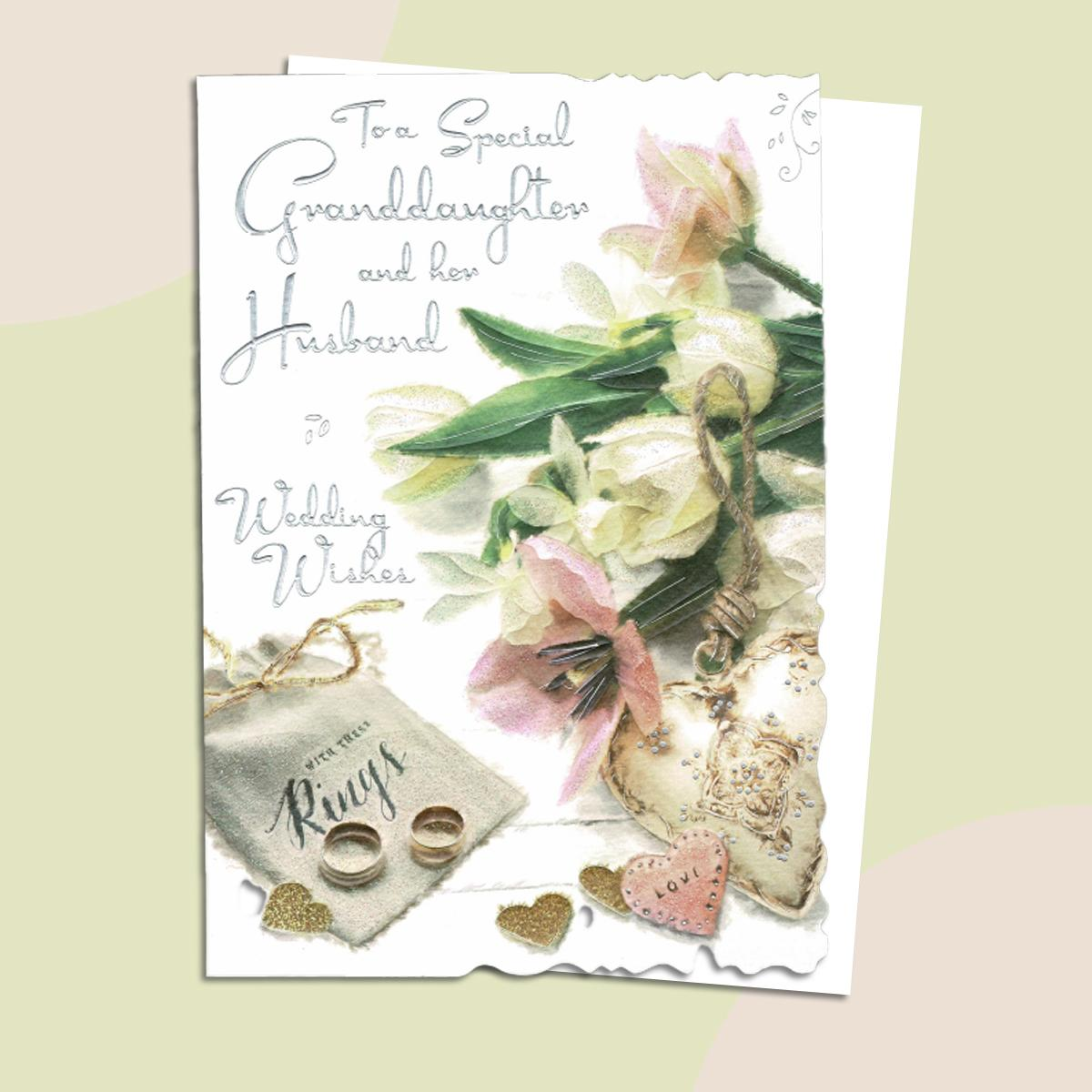Granddaughter And Husband Wedding Card Alongside Its White Envelope
