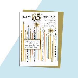 Age 65 Birthday Card Alongside Its Kraft Envelope