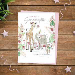 New Baby Granddaughter Congratulations Card Alongside Its Light Pink Envelope
