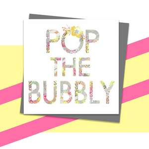 Pop The Bubbly Themed Greeting Card Alongside Its Dark Grey Envelope