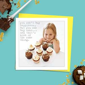Beautiful Photographic Funny Card Showing A Young Girl Smiling At A table Full Of Delicious Looking Cupcakes. Caption: You Can't Buy Happiness, But You Can Buy Cake... And That's Kind Of The Same Thing. Blank Inside For Own Message. Complete With Neon Yellow Envelope