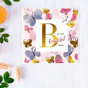 Butterfly Themed Mother's Day Design Alongside Its White Envelope