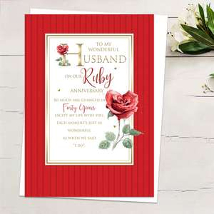 ' To My Wonderful Husband On Our Ruby Anniversary' Featuring Red Stripes With Red Roses And Heartfelt Words Edged In Gold Foiling Detail. Complete With White Envelope