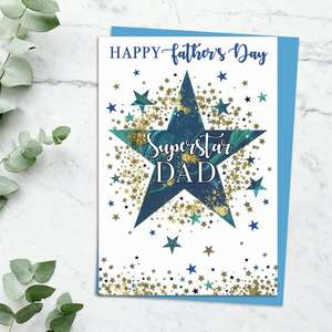 'Happy Father's Day Superstar Dad' Card Featuring A Starburst! With Added Gold Sparkle And Blue Envelope