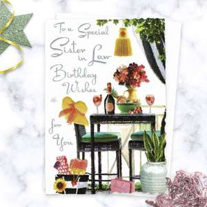 ' To A Special Sister In Law Birthday Wishes For You' Card Featuring A Birthday Lunch Scene With Red Wine, Flowers And Table Set. With Sparkle, Silver Foil Detail And White Envelope