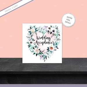 Floral Wedding Acceptance Card Sitting On A Display Shelf