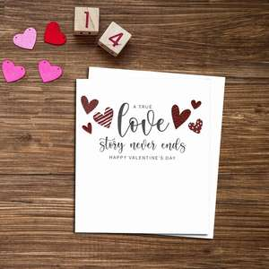 A True Love Story Never Ends Valentine's Day Card Alongside White Envelope