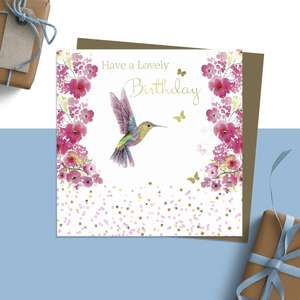 ' Have A Lovely Birthday' Design Featuring A Beautiful Hummingbird Among Vibrant Pink Blossom. Added Sparkle And Jewel Embellishment. Blank Inside For Own Message. Complete With Brown Kraft Envelope