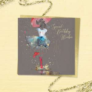 Beautiful 'Special Birthday Wishes' Card From The 'Grace' Range. Featuring A Young Lady In T Shirt And Frothy Skirt With Long Red Boots, Stepping Into A Puddle! With Added Sparkle And Gold Foil Detail. Colour Image Inside With Greeting: Happy Birthday. Complete With Gold Colour Envelope