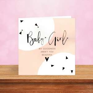 Baby Girl Card Sat On The Shelf