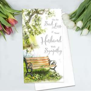 Loss Of Husband Sympathy Card Alongside Its White Envelope