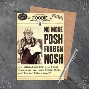 Posh Nosh Funny Birthday Card Sitting On A Display Shelf
