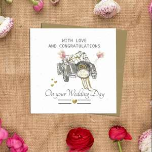 Wedding Day Design Alongside Its Kraft Envelope