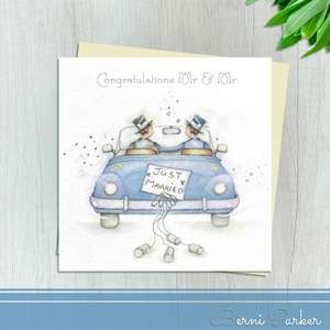 Two Grooms On Their Wedding Day Shown In the Wedding Car. Finished With Silver Accents And Complete With An Ivory Envelope