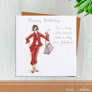 Lady Dressed In Red Trouser Suit Wearing Sunglasses, Bracelet and Handbag. Caption: Happy Birthday To A Lady Who Doesn't Look A Day Over Fabulous! Blank Inside For Your Own Message . Complete With a Bronze Coloured Envelope