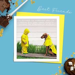 Beautiful Photographic Funny Card Showing A Small Boy With A Ball And A Large Dog Both Wearing Yellow Waterproof Coats. Caption: ' A Friend Is Someone Who is There For You When They'd Rather Be Somewhere Else...'. Blank Inside For Own Message. Complete With Neon Yellow Envelope