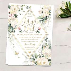 ' To A Very Special Mum And Dad On Your Diamond Anniversary' Featuring Cream And White Flowers And Gold Foiled Butterflies. Complete With White Envelope
