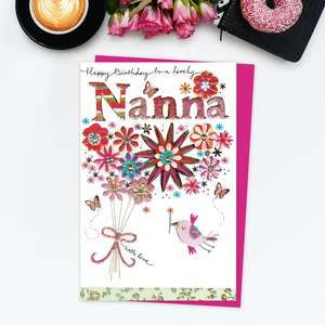 'Happy Birthday To A Lovely Nanna' Card Featuring A Bright And Vibrant Starburst Of Flowers With A Bird And Butterflies! Complete With Gold Foil Detail And Cerise Envelope
