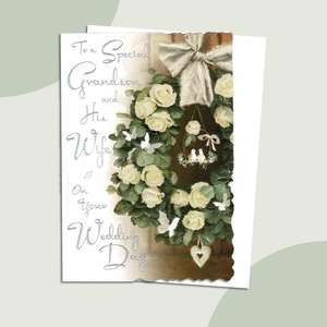 Special Grandson And Wife Wedding Card Alongside Its White Envelope