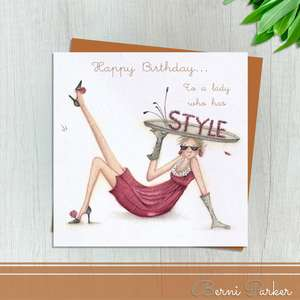 A Long legged Lady Under The Biggest Hat With Style Written On It . Caption: Happy Birthday To A Lady Who Has Style. Blank Inside For Your Own Message. Complete With Bronze Coloured Envelope