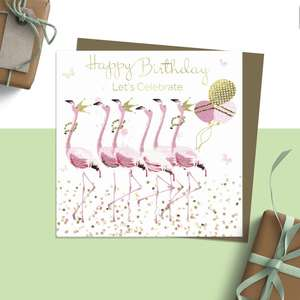 ' Happy Birthday Let's Celebrate' Design Featuring A Row Of Beautiful Pink Flamingos Wearing Gold Beads And Crowns And Carrying Balloons. Blank Inside For Own Message. Complete With Brown Kraft Envelope
