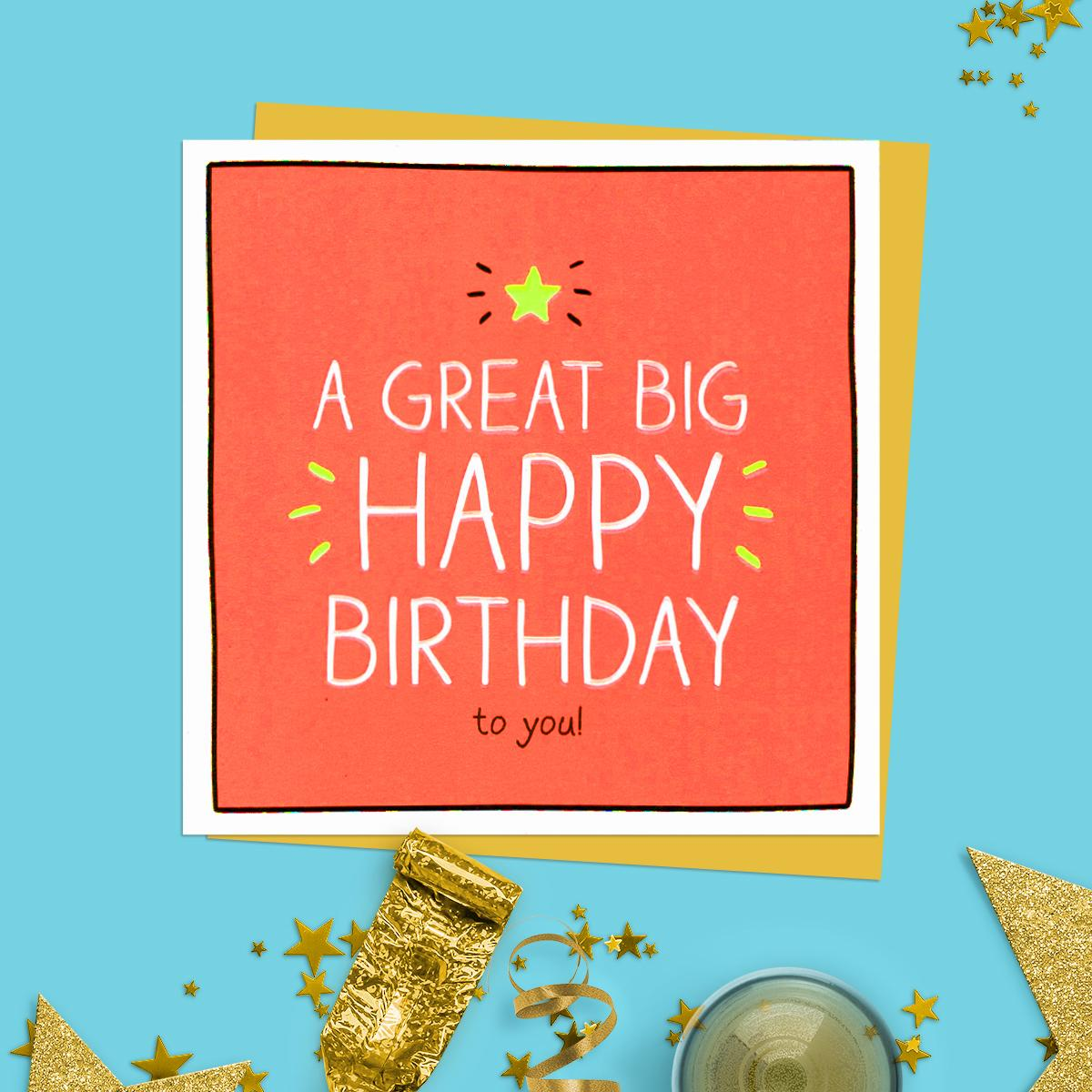 Great Big Happy Birthday Birthday Card Sitting On A Wooden Shelf