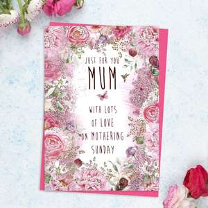 ' Just For You Mum With lots Of Love On Mothering Sunday' Featuring A Floral border Of Pink Flowers With Gold Foil Detail. Complete With Bright Pink Envelope