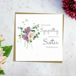 ' With Heartfelt Sympathy On The Loss Of Your Sister Thinking Of You' Card Featuring Beautiful Calla Lilies In Purple and Pink. With Discreet sparkle And Brown Envelope. Blank Inside For Own Message